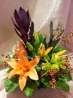 Asiatic lillies, leucadendron, cymbidium orchid, and waxflowers