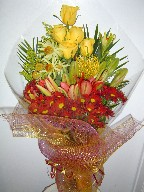 Roses, protea, lillies, daisies, solidago, and leucadendron