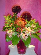Alstroemeria, coffee beans, solidago, dahlia, and protea