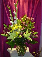 Gladiolas, lillies, waxflowers, solidago, and pompoms