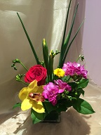 Rose, cymbidium orchid, iris, freesia, and pompom