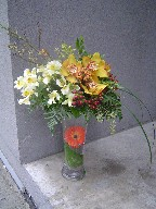 Cymbidium orchids, coffee beans, solidago, seed eucalyptus, gerbera, alstroemeria, and monky grass