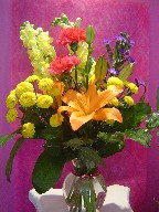 Snapdragon, carnations, pompoms, lillies, and monte casino blue