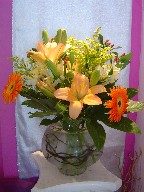 Lillies, alstroemeria, solidago, gerbera, and coffee beans