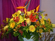 Bird of paradise, roses, lisianthus, lillies, solidago, daisies, helenium, and coffee beans
