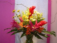 Ginger, lillies, pompoms, solidago, alstroemeria, monstera, and curly willow
