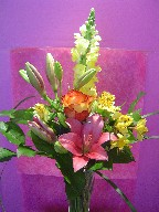Snapdragon, rose, lillies, and alstroemeria