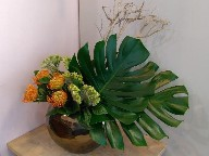 Protea, celosia, monstera, and branch
