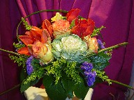Roses, cabbage, fresia, solidago, statice, and lillies