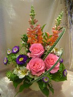Roses, snapdragon, aster, alstroemeria, and monkey grass