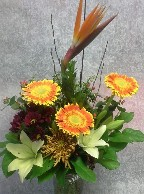 Bird of paradise, gerbera, asiatic lillies, cremons, daisies, hypericum, myrtle, and branch