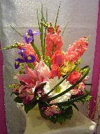 Iris, snapdragon, roses, lillies, solidago, alstroemeria, hydreangea, coffee beans, and monkey grass