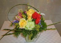 Solidago, asiatic lillies, casablanca, tulips, gold roses, and statice