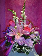 Lillies, roses, snapdragon, baby's breath, daisies, and statice