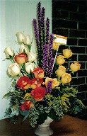 Yellow, two-tone and white roses, solidago, liatris and seeded eucalypthus