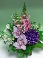 Commercial mum, cymbidium orchids, snapdragon, alstroemeria, and waxflowers