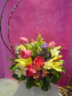 Pussy willow, tulips, lillies, alstroemeria, casino blue, roses, and waxflowers