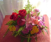 Solidago, daisies, red roses, and orange lillies
