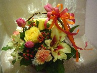 Shocking lilies, roses, tulips, daisies, carnations, and hypericum