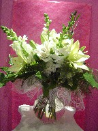 Snapdragon, alstroemeria, lillies, roses, carnations, and philodendron