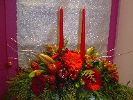 Coffee beans, gerbera, carnations, seed eucalyptus, Christmas ornaments, pine, pine cones, and lillies