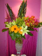 Sago palm, astilbe, gerbera, solidago, daisies, alstroemeria, lillies, and monstera