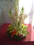 Snapdragon, yellow roses, gerbera, and white lillies