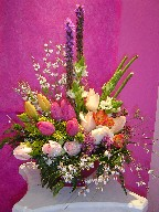 Liatris, tulips, freesia, star of bethlehem, genest, solidago, wax flowers, and roses
