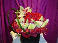 Roses (30), cymbidium orchids, and monkey grass