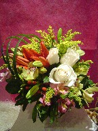 Roses, lillies, orchids, coffee beans, alstroemeria, solidago, and monkey grass