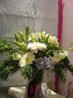 Alstroemeria, Star of Bethlehem, dendrobium orchids, gerbera, pine, and Christmas branch