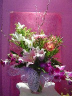 Lillies, iris, solidago, alstroemeria, gerbera, orchids, and curly willow