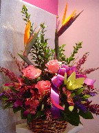 Bird of paradise, heather, roses, alstroemeria, lillies, dendrobium orchids, and statice
