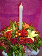 Roses, lillies, carnations, daisies, berries, pine, and Christmas decoration