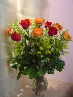 Dozen roses and solidago