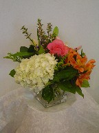 Hydreangea, roses, alstroemeria, lillies, and solidago