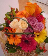 Mango calla lillies, roses, gerbera, lillies, coffee beans, and monkey grass
