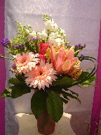 Gerbera, lillies, roses, stock, statice, solidago, and monkey grass