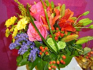 Roses, lillies, statice, coffee beans, solidago, dasies, and alstroemeria