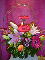 Gerbera, lillies, solidago, tulips, daisies, heather, and curly willow