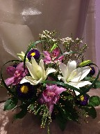 Cymbidium orchids, asiatic lillies, aster, waxflowers, and monkey grass
