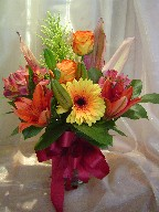Gerbera, roses, alstroemeria, lillies, and solidago