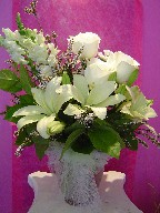 Roses, snapdragon, lillies, and thryptomene