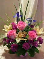 Cymbidium orchids, roses, iris, pompoms and greens