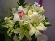 Cymbidium orchids, roses, lillies, alstroemeria, and ruscus