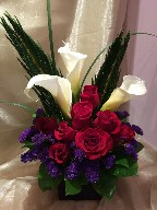 Calla lilies, red roses, statice and bear grass