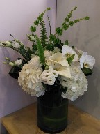 Hydreangeas, roses, lisianthus, orchids, calla lillies, bells of Ireland, and aspedistra