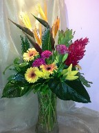 Bird of paradise, ginger, gerbera, celosia, asiatic lillies, sago palm, eucadendron, and anthurium leaves