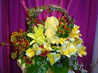 Roses, coffee beans, alstroemeria, helenium, thrytomene, and seed eucaplyptus