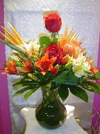 Roses, alstroemeria, bird of paradise, protea, lillies, and coffee beans